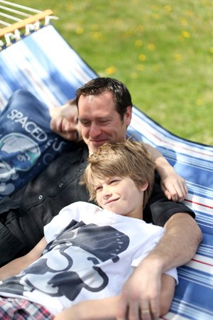 Joachim hanging with his sons August and Maddox.