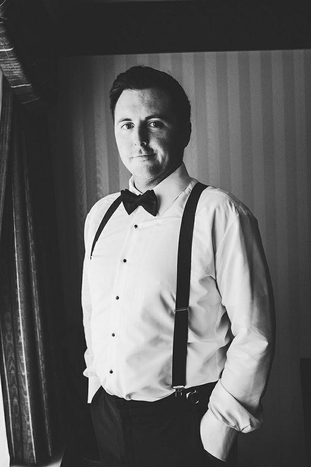 Black and white portrait of groom prior to the wedding