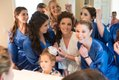 Bridal party checking hair and makeup in front of large mirror