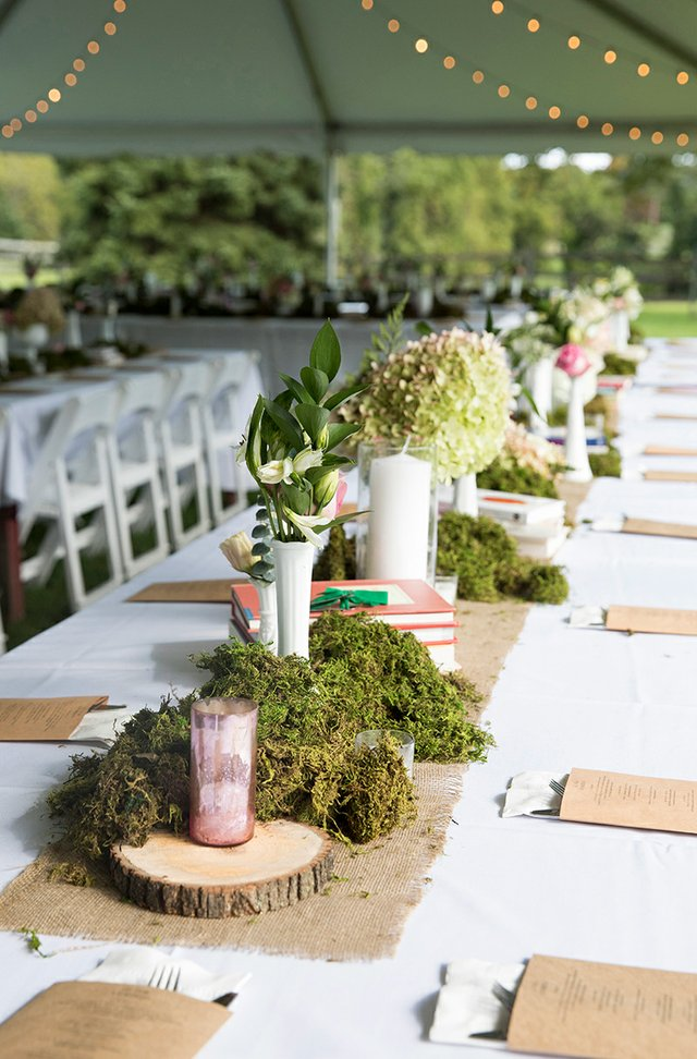 Wedding reception long table with wood, burlap, moss and greenery centerpieces