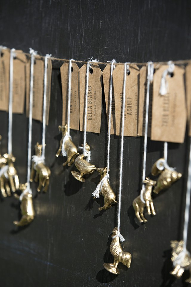 Brass animal tokens used for table cards and wedding favors