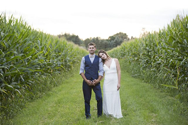 Photo of bride and groom in cornfield
