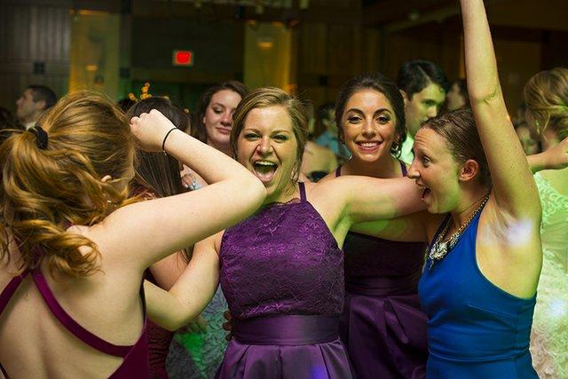 Bridesmaids having fun on dance floor
