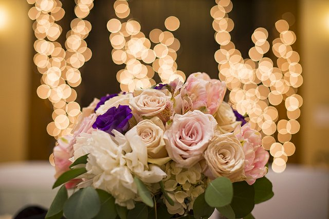 Close-up of wedding bouquet of roses with bokeh background