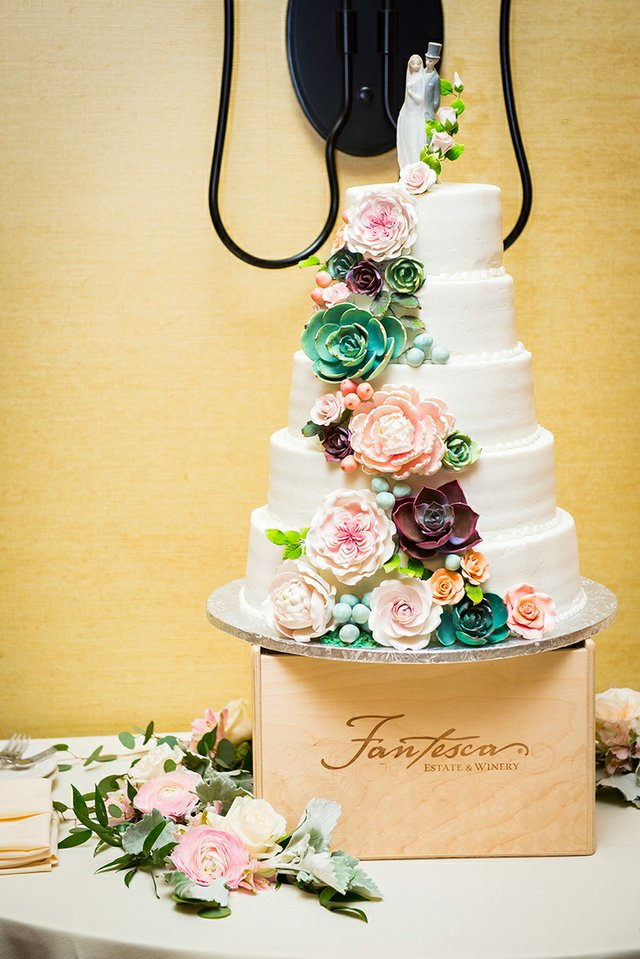 Tiered wedding cake with pearl and floral icing
