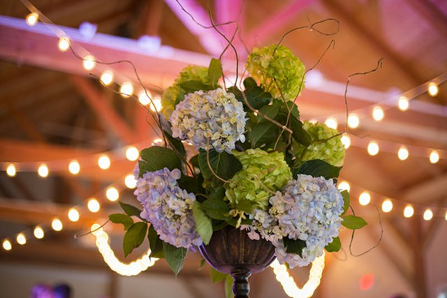 Closeup of floral centerpiece with bokeh lights in background