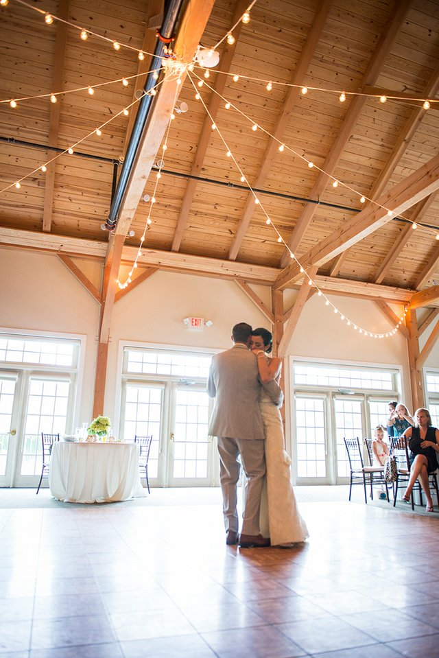 Bride and groom's first dance, vaulted ceiling with string lights