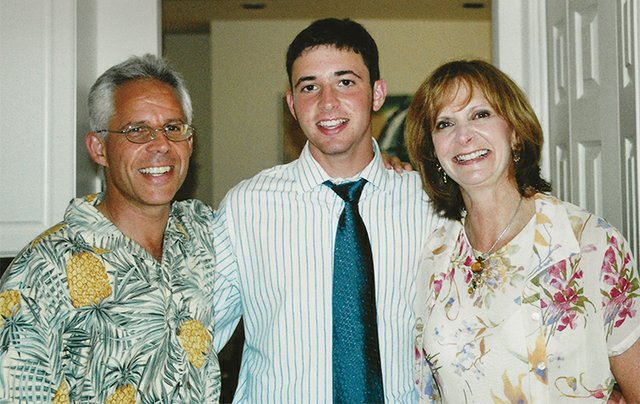 Elliot, Justin and Linda Sheftel on the day Justin graduated.
