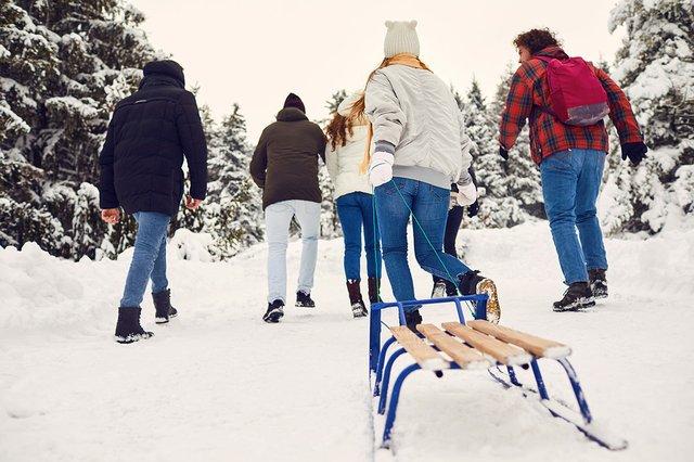 friends-sledding-snow-scene-web.jpg